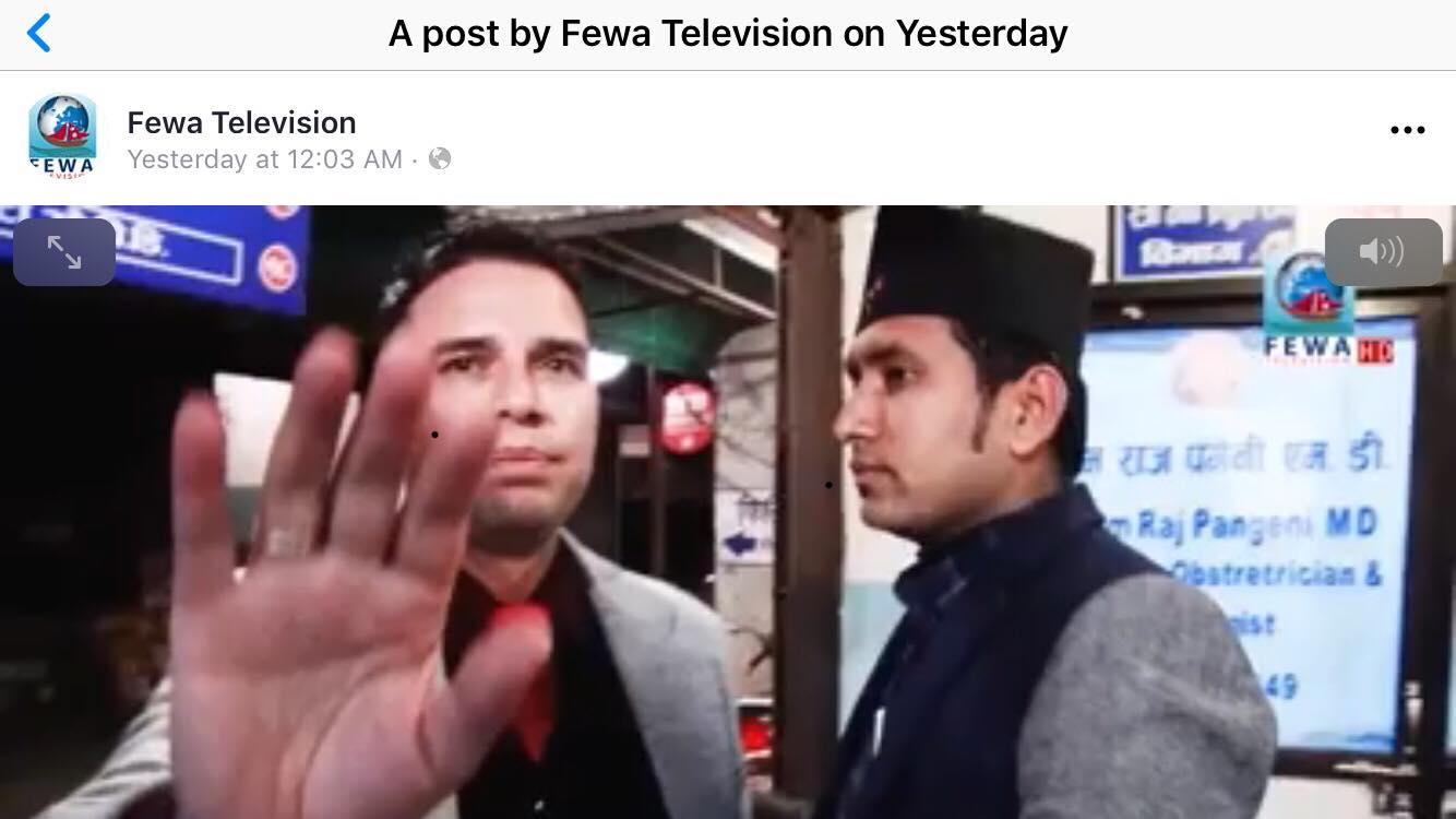 Health professional manhandles reporter